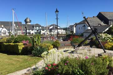 The communal gardens to the front of the house, with the marina directly beyond.