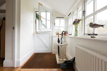 The porch provides a perfect place for donning walking boots or drying soggy dogs!