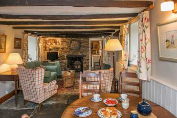 The cottage retains many of its original features with gorgeous flagstone floors and rustic beams.
