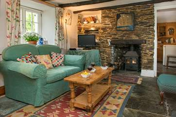 The sitting/dining-room has a cosy multi-burner.