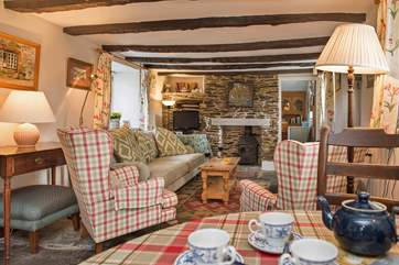 The cottage retains many of its original features with flagstone floors and rustic beams