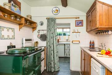 The country kitchen has a lovely Aga creating a warm welcome all year round