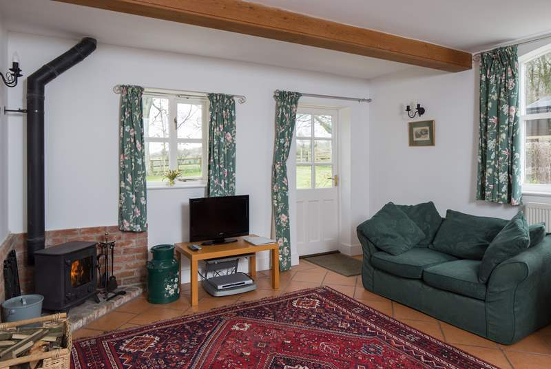 The sitting/dining-room welcomes you to the cottage, the wood-burner is perfect for a cosy evening in.