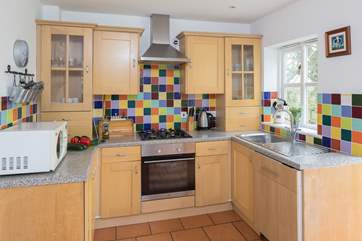 The bright and cheery kitchen has all that you need to create a light snack or a delicious feast.