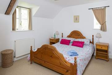 The master bedroom has a king-size bed and en suite bathroom (Bedroom 1).