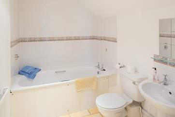 The en suite bathroom is spacious and light.