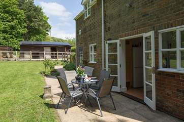 The private terrace at the back of the cottage has French doors that lead into the kitchen, perfect for al fresco dining.