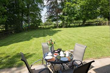 The fully enclosed garden looks out over the rolling Dorset countryside.