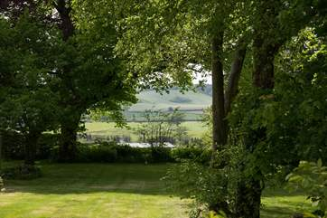 Wonderful views from the private garden through a copse and across the valley.