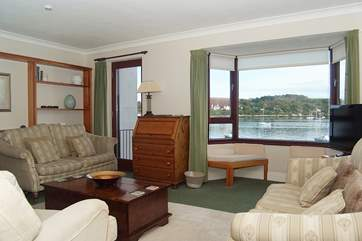 The main sitting-room on the first floor has superb views out over the water.
