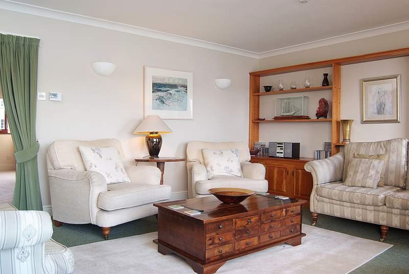 The sitting-room is elegantly furnished and very comfortable.
