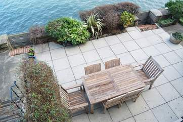 Looking down at the waterside terrace from the first floor sitting-room balcony (please take care with children).