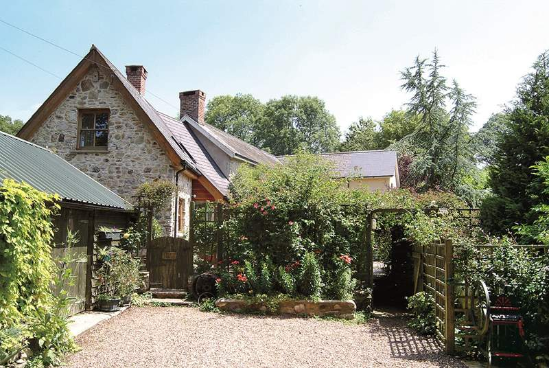 The cottage has plenty of parking space and an enclosed terrace/patio.