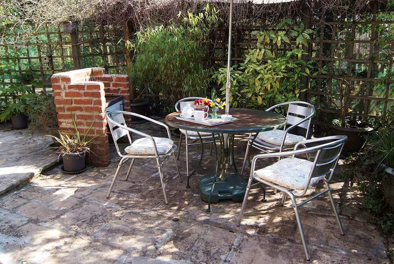 The pretty courtyard garden has a brick built barbecue for you to enjoy.