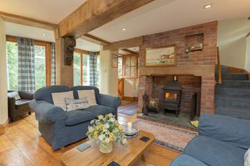 The living-room is so cosy with its wood-burning stove and comfortable sofas.