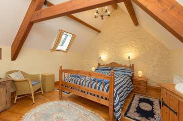 This is the lofty master bedroom. A lovely spacious room.