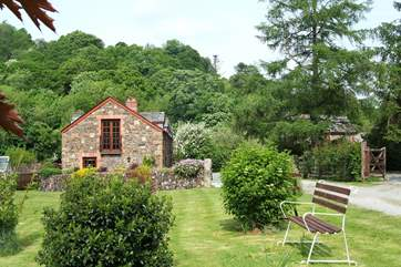Leat Mill looks out over private fields and woodland and has a gated sun-trap patio in front of the cottage.