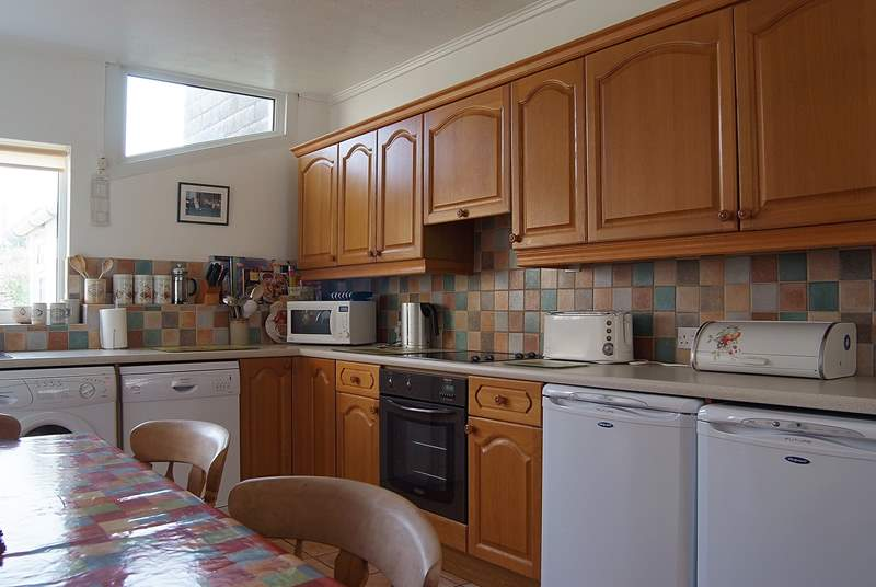 The well-equipped kitchen/breakfast-room has a large farmhouse dining-table.