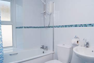 The modern first floor bathroom with a fitted shower.