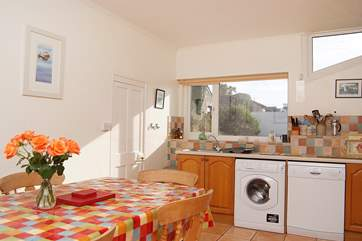 The spacious kitchen looks out over the huge garden.