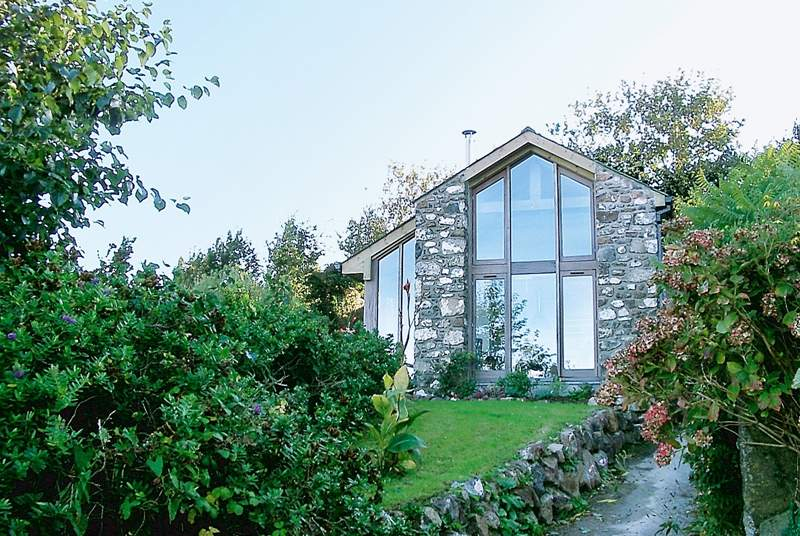 The exterior of Skylight Barn with floor to ceiling windows to make the most of the amazing views.
