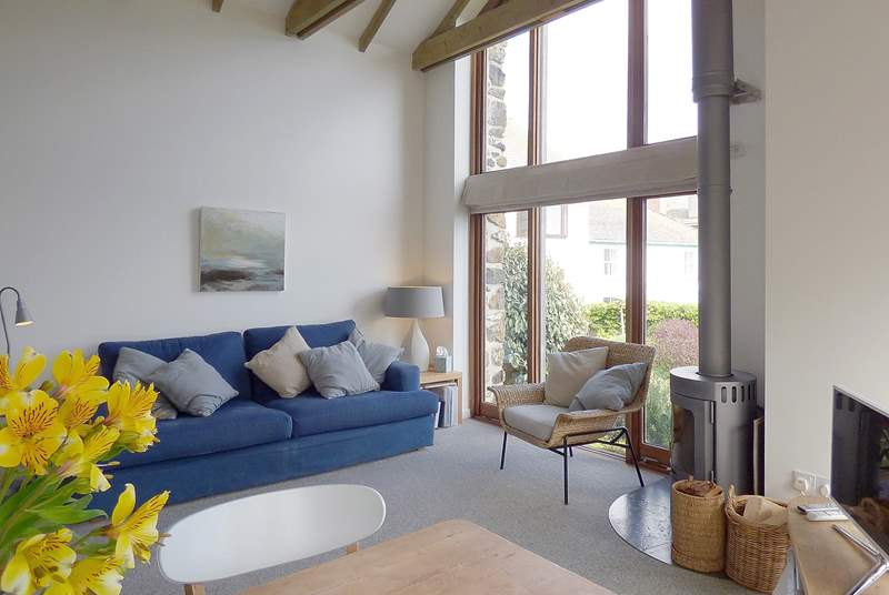 Modern, light and comfortably furnished with a cosy wood-burner for those cooler evenings.