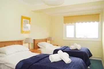 Bedroom 3 (ground floor) has twin beds.