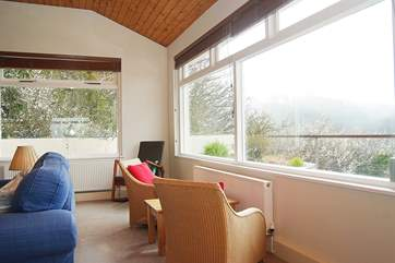 There are superb views across the river from the sitting-room, bedrooms and garden.
