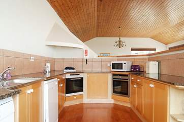 The kitchen-area is hidden behind a chest-height wall so you can see the views while cooking.