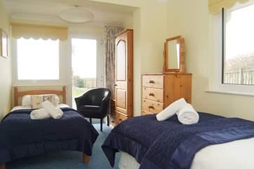 Bedroom 4 (ground floor) has twin beds.