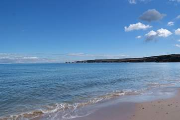 There is a wonderful stretch of sandy beach at Studland, with car parking, water sports and a National Trust cafe and shop.