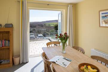 The dining-room has French windows out onto the balcony and magnificent views beyond.