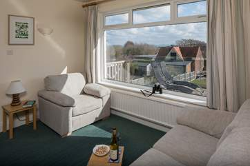 The sitting-room shares the panoramic view of the countryside with the sea beyond and the Isle of Wight on a clear day.