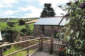 The pretty garden enjoys lovely views over the countryside.