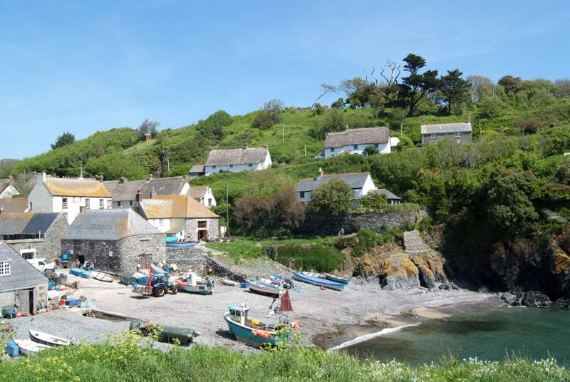 Man o' War is set high above Cadgwith Cove (last on the right in the photograph), with glorious views over the bay and the village.