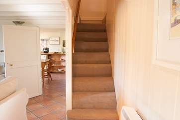 The stairs rise up from the sitting-room to the bedrooms with a split level landing at the top.