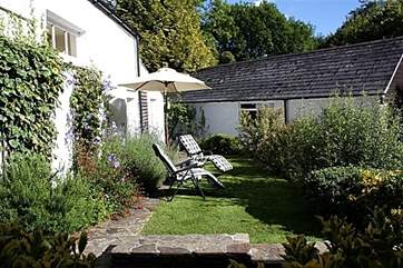 The garden in front of the cottage is a delight on a sunny day.