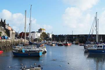 Mevagissey is a working fishing port with narrow streets, ancient pubs and cosy tea-rooms.