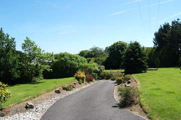 The private driveway through the garden.