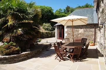 The sunny dining-area in the sheltered courtyard.