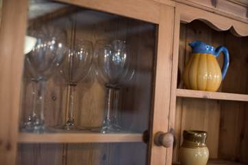 A pine dresser for glasses and other bits and bobs.