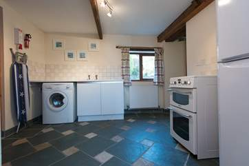 The utility-room has an electric cooker, washing machine and fridge/freezer, plus a shower-room and separate WC.