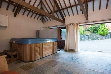 The garden-room houses the wonderful hot tub, and doors open out to a sheltered courtyard.