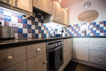 The galley kitchen is small but fully equipped.