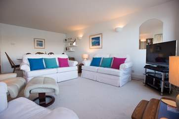 Comfortable sofas and armchairs and a large TV with PVR for plenty of viewing choice.