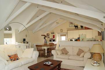 The spacious and comfortable open plan living-room.