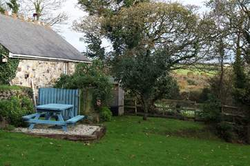 The peaceful gardens with countryside views.