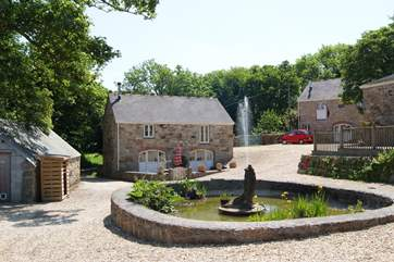 Looking towards Orchard Barn across the pond in the shared courtyard.