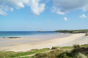 Miles of golden sands stretch between Hayle beach and Godrevy lighthouse.