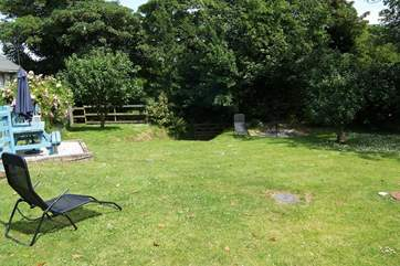 The spacious and enclosed back garden, room to play or simply relax.